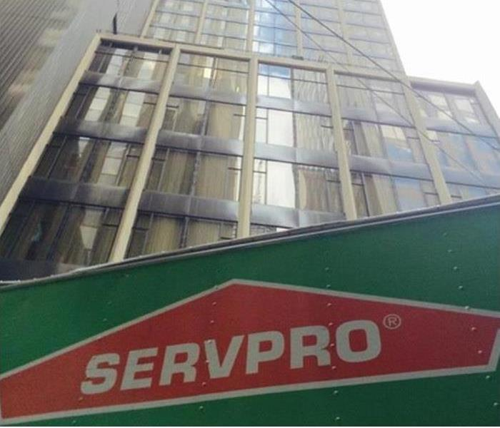 Commercial building with SERVPRO truck in front of it